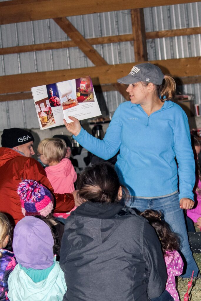 Angie Tauer reads to farm families.