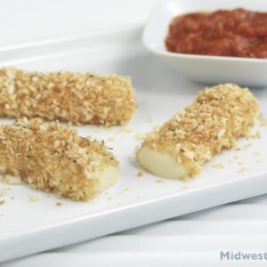 Baked mozzarella sticks on a plate with a side dish of marinara.