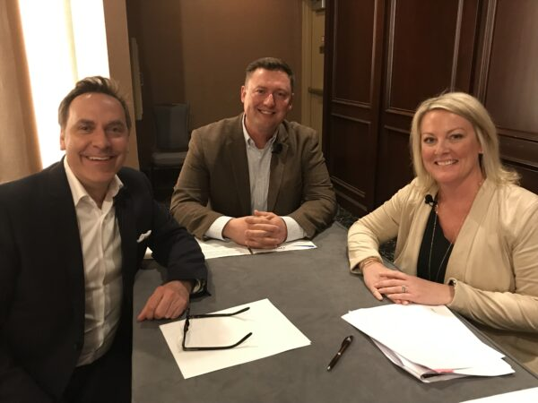 Former Midwest Dairy CEO Lucas Lentsch sits at a table with Beth Engelmann, chief marketing communications officer at Dairy Management, Inc. and Victor Zaborsky, vice president of marketing at MilkPEP.