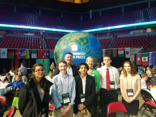 Former Midwest Dairy CEO Lucas Lentsch and a group of teens at the World Food Prize conference in Iowa.